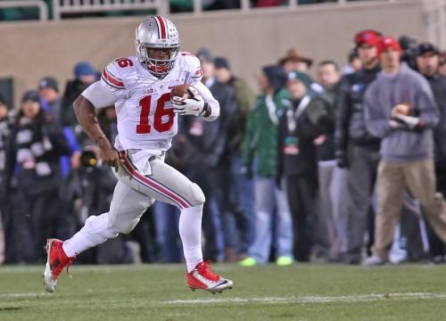 Redshirt-freshman quarterback J.T. Barrett carries the ball during a game against Michigan State on Nov. 8 in East Lansing, Mich. OSU won, 49-37. Credit: Mark Batke / Photo editor