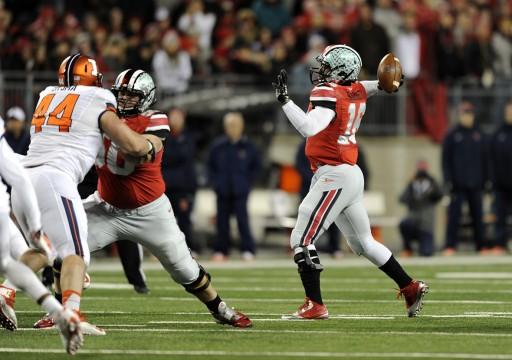 Redshirt-freshman quarterback attempts a pass during a game against Illinois Nov. 1 at Ohio Stadium. OSU won, 55-14.  Credit: Ben Jackson / For The Lantern