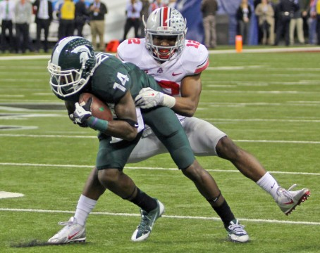 OSU then-junior cornerback Doran Grant (12) tackles Michigan State then-redshirt-junior wide receiver Tony Lippett (14) during the 2013 Big Ten Championship Game on Dec. 8, 2013 in Indianapolis. OSU lost, 34-24. Credit: Ritika Shah / LanternTV news director