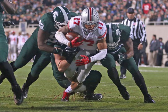 Redshirt-freshman H-back Jalin Marshall (17) carries the ball during a game against Michigan State on Nov. 8 in East Lansing, Mich. OSU won, 49-37. Credit: Mark Batke / Photo editor