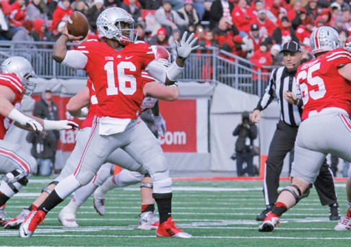 Redshirt-freshman quarterback J.T. Barrett (16) attempts a pass during a game against Indiana on Nov. 22 at Ohio Stadium. OSU won, 42-27. Credit: Jon McAllister / Asst. photo editor