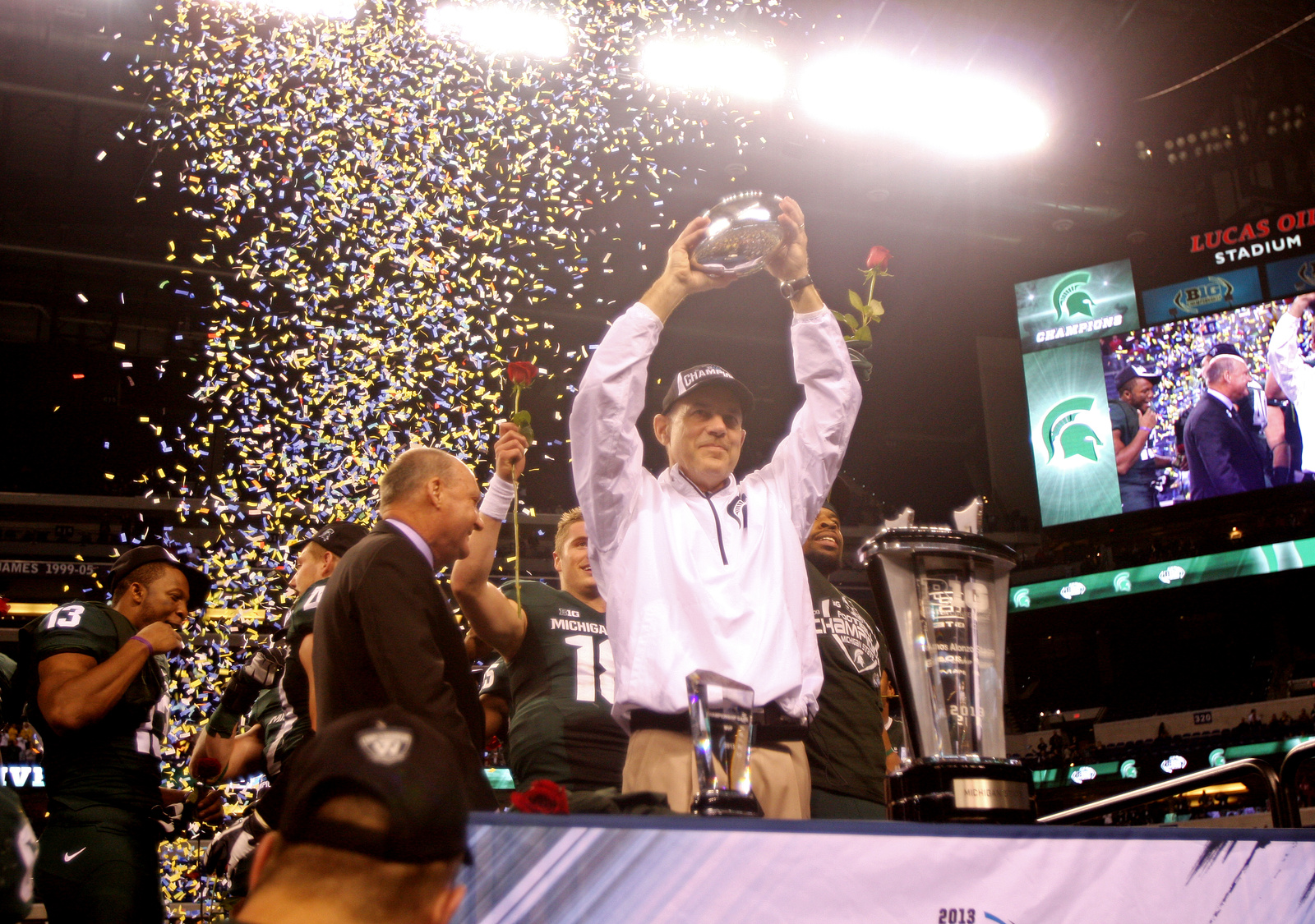 Michigan State coach Mark Dantonio holds the trophy above his head after the game. OSU lost to Michigan State, 34-24, in the Big Ten Championship at Lucas Oil Stadium in Indianapolis Dec. 7. Credit: Lantern file photo