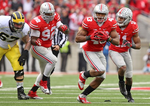 Redshirt-freshman linebacker Darron Lee (43) runs a recovered fumble to the end zone during a game against Michigan on Nov. 29 at Ohio Stadium. OSU won, 42-28. Credit: Mark Batke / Photo editor