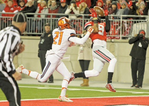 Senior wide receiver Devin Smith (9) hauls in a catch for a touchdown during a game against Illinois on Nov. 1 at Ohio Stadium. OSU won, 55-14 as Smith caught a pair of touchdowns from redshirt-freshman quarterback J.T. Barrett. Credit: Mark Batke / Photo editor