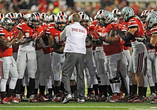 Coach Urban Meyer huddles with members of the Ohio State football team prior to a game against Illinois on Nov. 1 at Ohio Stadium. OSU won, 55-14. Credit: Ben Jackson / For The Lantern
