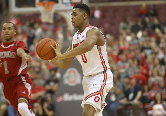Freshman guard D'Angelo Russell (0) passes the ball during a game against Sacred Heart on Nov. 23 at the Schottenstein Center. OSU won, 106-48. Credit: Mark Batke / Photo editor