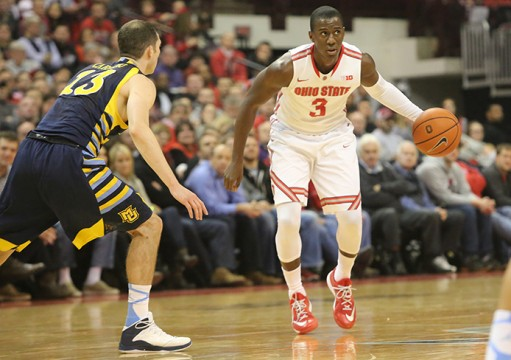 Senior guard Shannon Scott (3) dribbles the ball during a game against Marquette on Nov. 18 at the Schottenstein Center. OSU won, 74-63. Credit: Muyao Shen / Lantern photographer