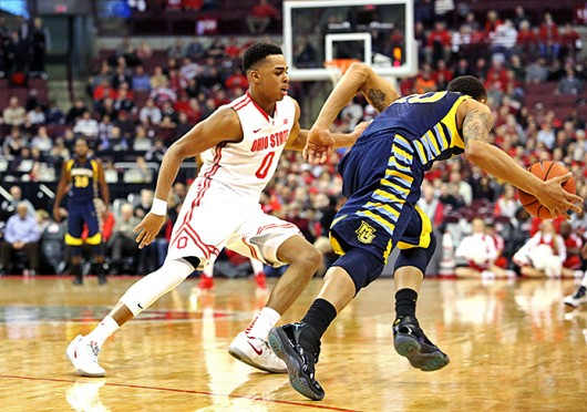 Freshman guard D'Angelo Russell (0) plays defense during a game against Marquette on Nov. 18 at the Schottenstein Center. OSU won, 74-63. Credit: Muyao Shen / Lantern photographer