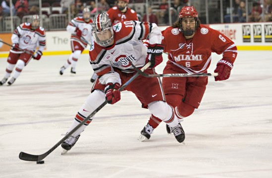 OSU senior forward Darik Angell advances the puck during a game against Miami (OH) Oct. 17. at the Schottenstein Center. OSU lost, 5-1. Credit: Michael Griggs / For The Lantern