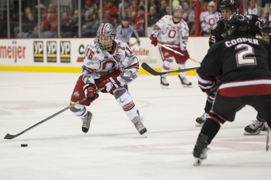Senior forward Tanner Fritz (16) skates with the puck during a game against Nebraska-Omaha on Nov. 7 at the Schottenstein Center. OSU lost, 4-1. Credit: Michael Griggs / For The Lantern