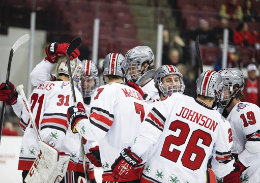 Members of the OSU men's hockey team huddle during a 3-0 win against Michigan State on Nov. 21 at the Schottenstein Center. Credit: Kelly Roderick / For The Lantern
