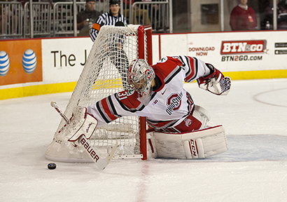 Sophomore goalie Matt Tomkins reaches for the puck during a game against Miami (Ohio) on Oct. 17 at the Schottenstein Center. OSU lost, 5-1. Credit: Michael Griggs / For The Lantern