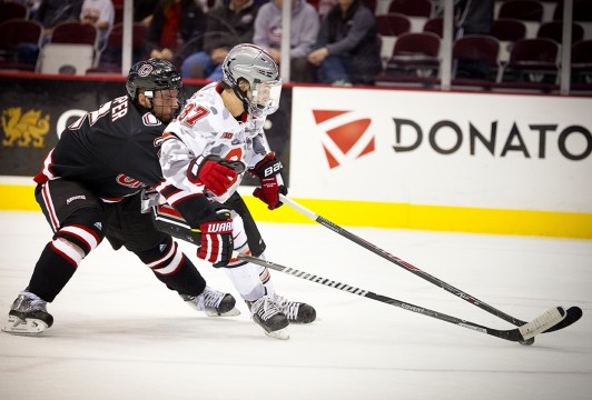 OSU sophomore forward Nick Schlikey attempts to separate from a defender during a game against Nebraska-Omaha Nov. 8 at the Schottenstein Center. OSU lost, 4-3.  Credit: Kelly Roderick / For The Lantern