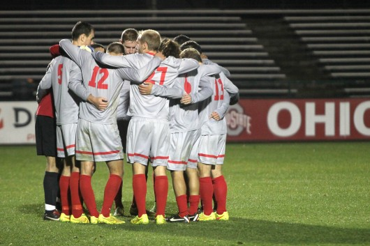 Members of the OSU men's soccer team huddle during a game against Rutgers on Oct. 25 at Jesse Owens Memorial Stadium. OSU won, 4-1. Credit: Taylor Cameron / Lantern photographer