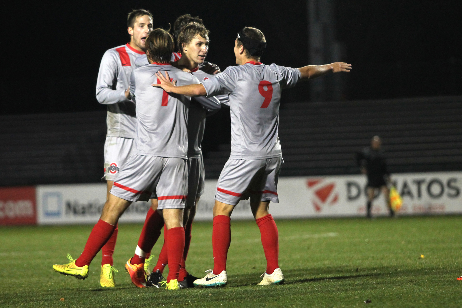 Members of the OSU men's soccer team celebrate during a 4-1 win against Rutgers on Oct. 25, 2014, at Jesse Owens Memorial Stadium.  Credit: Lantern File Photo