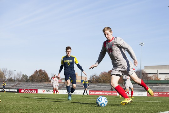 Sophomore defender Austin Mergstrom (25) kicks the ball during a game agaisnt Michigan in the first round of the Big Ten Tournament on Nov. 9 at Jesse Owens Memorial Stadium. OSU won, 1-0. Credit: Kelly Roderick / For The Lantern