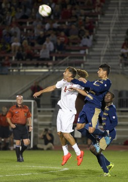 Senior midfielder Yianni Sarris (left) fights for a header during a game against Akron on Sept. 24 at Jesse Owens Memorial Stadium. OSU lost, 3-1. Credit: Ben Jackson / For The Lantern