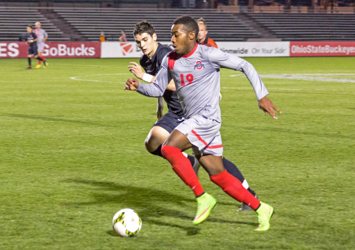 OSU freshman forward Marcus McCrary pushes the ball upfield in a game against Rutgers