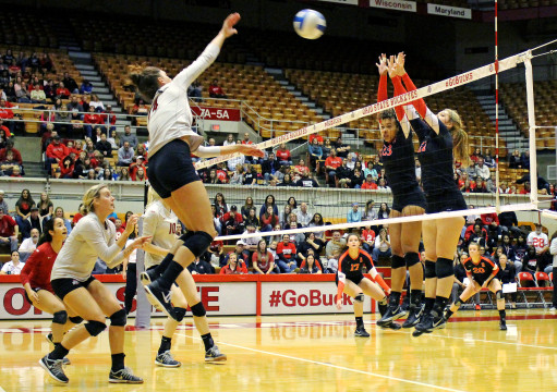 OSU junior outside hitter Elizabeth Campbell spikes the ball in the direction of two Rutger players in a match against the Scarlet Knights Nov. 8 at St. John Arena. OSU won, 3-0.  Credit: Molly Tavoletti / Lantern photographer
