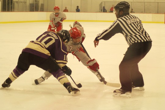 OSU junior forward Julia McKinnon faces off with a Western Ontario player Sept. 28 during an exhibition match at the OSU Ice Rink. OSU and Western Ontario tied 2-2 in OT.  Credit: Melissa Prax / Lantern photographer