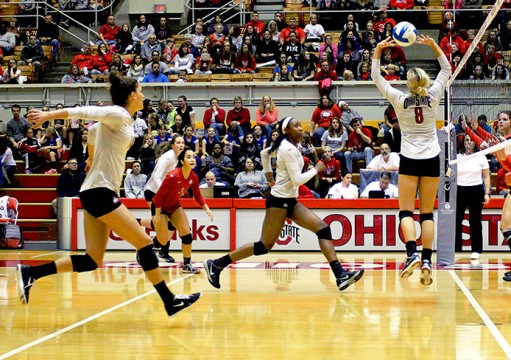Members of the Ohio State women's volleyball team attempt to make a play on the ball in a game against Rutgers on Nov. 8 at St. John Arena. OSU won, 3-0. Credit: Molly Tavoletti