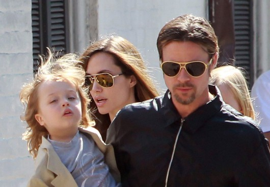 Brad Pitt (left), Angelina Jolie and their daughter Shiloh go for a walk in their neighborhood on March 20, 2011 in New Orleans. Credit: TNS
