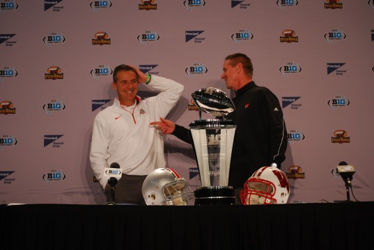 OSU coach Urban Meyer (left) and Wisconsin coach Gary Andersen exchange laughs during a Dec. 5 press conference at Lucas Oil Stadium in Indianapolis ahead of the Big Ten Championship Game.  Credit: Tim Moody / Sports editor