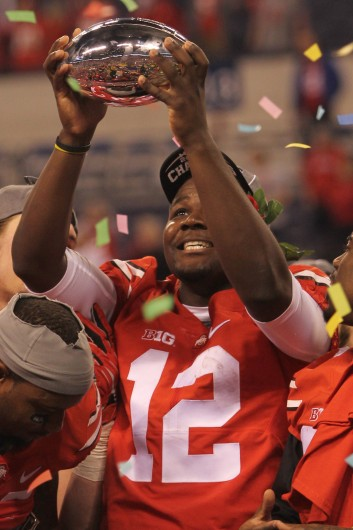 Redshirt-sophomore quarterback Cardale Jones holds the Big Ten Championship trophy after OSU's 59-0 win over Wisconsin in the conference title game on Dec. 6 in Indianapolis. Credit: Mark Batke / Photo editor