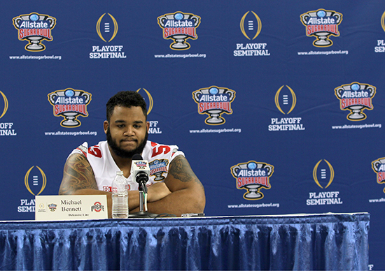 Senior defensive lineman Michael Bennett answers questions from the media during OSU's media day on Dec. 30 at the Mercedes-Benz Superdome in New Orleans. Credit: Mark Batke / Photo editor