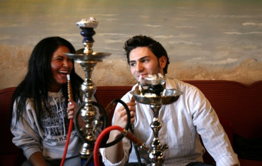 Olivia Polychroni, 18, left, and friend Ahmad Seblini, 18, smoke hookah at Sinbad Grand Cafe in Dearborn, Michigan, April 25, 2007. Credit: Courtesy of TNS