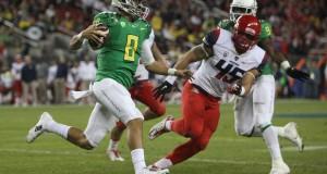 Oregon redshirt-junior quarterback Marcus Mariota (8) carries the ball during the Pac-12 Championship Game against Arizona in Santa Clara, Calif., on Dec. 5. Oregon won, 51-13. Credit: Courtesy of TNS