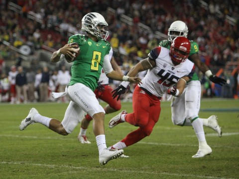 Oregon redshirt-junior quarterback Marcus Mariota (8) carries the ball during the Pac-12 Championship Game against Arizona in Santa Clara, Calif., on Dec. 5. Oregon won, 51-13. Credit: Courtesy of TNS