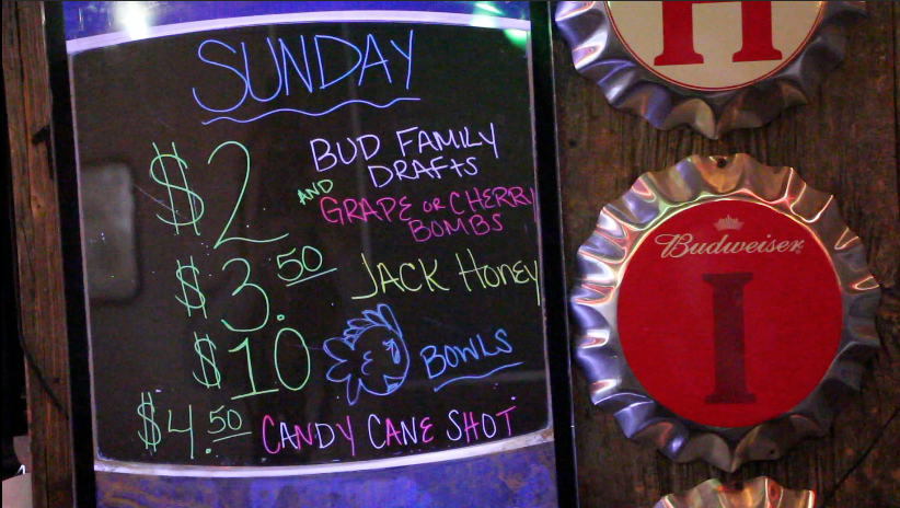 Drink specials are hung in a bar. Credit: Chelsea Spears / Multimedia editor