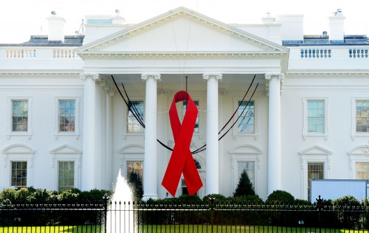 A red ribbon is displayed on the North Portico of the White House on Dec. 1, 2014, to commemorate World AIDS Day in Washington, D.C. Credit: TNS