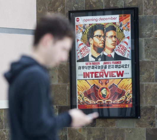 A poster for the movie 'The Interview' is seen at the AMC Glendora 12 movie theater. The three largest theater chains in the U.S. — Regal, AMC and Cinemark  — have decided not to screen the movie when it debuts Christmas Day.  Credit: Courtesy of TNS