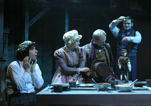 From left: jeff Horst, Beth Conley, Ben Sostrom and Andrew Protopapas with Tiny Tim in a scene from CATCO's production of 'A Christmas Carol,' which is set to run form Dec. 3-21 at Studio One in the Riffe Center Credit: Courtesy of Sarah Bacha