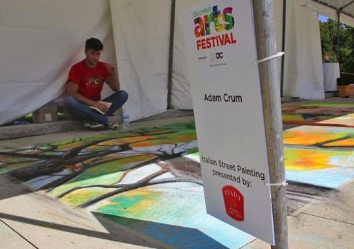 Chalk artist Adam Crum waits at his booth at the 2014 Columbus Arts Festival. Credit: Khalid Moalim / Asst. multimedia editor