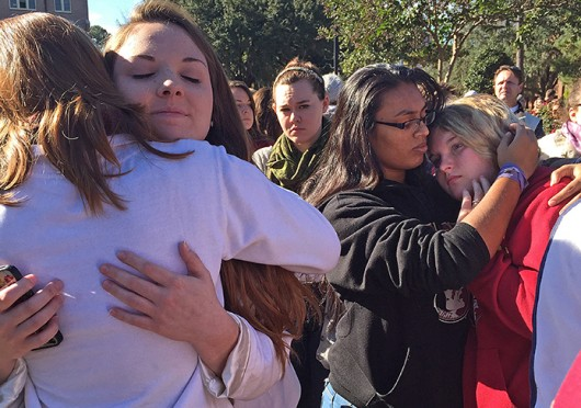 Students comfort each other the morning of Nov. 20 after the previous night's shooting at Florida State University's Strozier Libarary in Tallahassee, Fla. Credit: TNS