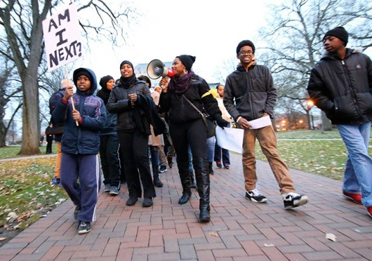Protesters take to the Oval Monday, Dec. 8 to take a stand against the Ferguson decision and police brutality.  Credit: Yann Schreiber / Lantern reporter
