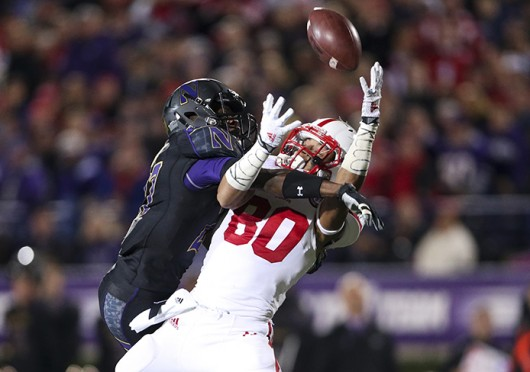 Northwestern Wildcats cornerback Matthew Harris (27) blocks Nebraska Cornhuskers wide receiver Kenny Bell (80) from making a catch during the second quarter at Ryan Field Oct. 18, 2014, in Evanston, Ill. Credit: Courtesy of TNS