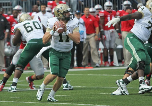UAB's Then-redshirt-freshman quarterback Austin Brown (11) scans the field during a 29-15 loss to OSU on Sept. 22, 2012, at Ohio Stadium. Credit: Lantern file photo