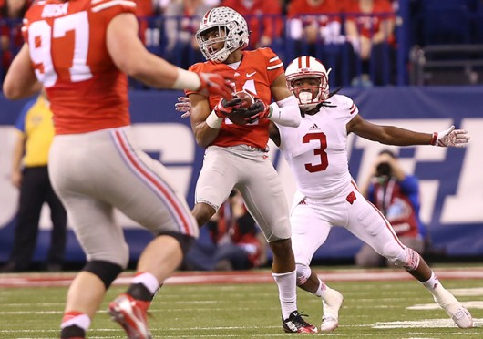 Sophomore safety Vonn Bell (11) intercepts a pass from Wisconsin redshirt-junior quarterback Joel Stave during the Big Ten Championship Game on Dec. 6 in Indianapolis. OSU won, 59-0. Credit: Mark Batke / Photo editor