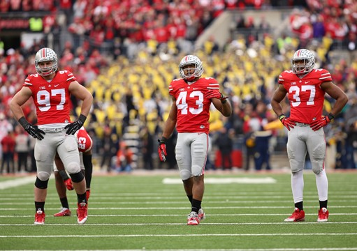Sophomore defensive lineman Joey Bosa (97), redshirt-freshman linebacker Darron Lee (43) and junior linebacker Joshua Perry (37) get set before a play against Michigan on Nov. 29 at Ohio Stadium. OSU won, 42-28. Credit: Mark Batke / Photo editor