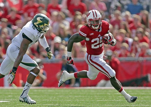 Wisconsin redshirt-junior running back Melvin Gordon (25) carries the ball during a game against South Florida at Camp Randall Stadium in Madison, Wis., on Sept. 27. Wisconsin won, 27-10. Credit: Courtesy of TNS