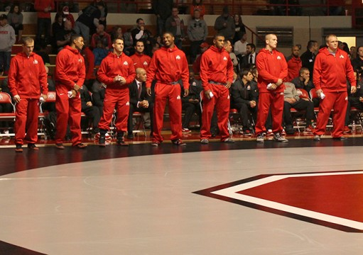Members of the OSU wrestling team stand near the team bench during a match against Kent State on Nov. 13. OSU won, 38-3. Credit: Emily Yarcusko / For The Lantern