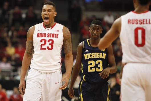 Senior center Amir Williams (23 in white) celebrates during a game against Michigan on Jan. 13 at the Schottenstein Center. OSU won, 71-52. Credit: Kelly Roderick / For The Lantern