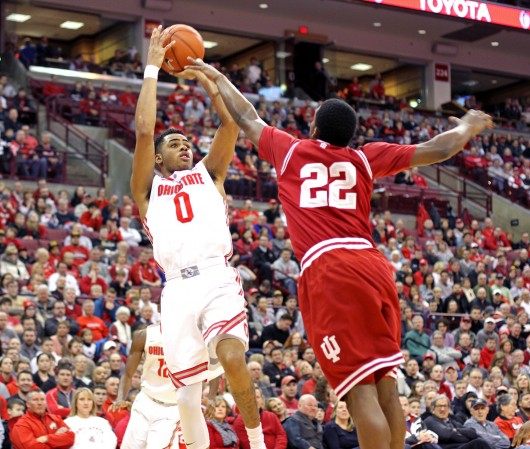 D'Angelo Russell (0) attempts a shot over Indiana sophomore guard Stanford Robinson (22) during a Jan. 25 game at the Schottenstein Center. OSU won, 82-70.  Credit: Samantha Hollingshead / Lantern photographer