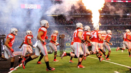 OSU players run onto the field before kickoff at the 2015 College Football Playoff National Championship against Oregon on Jan. 12 in Arlington, Texas. OSU won, 42-20. Credit: Mark Batke / Photo editor