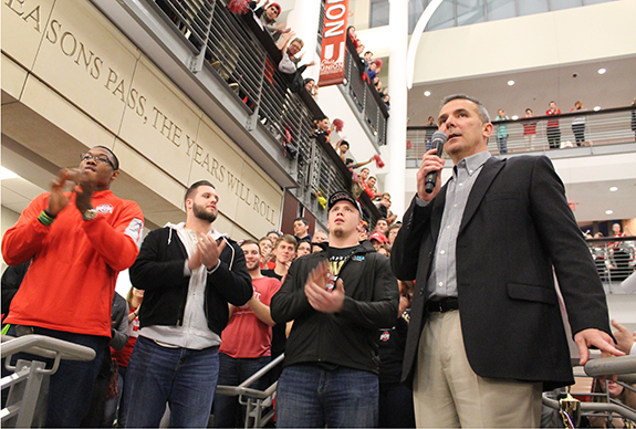 Coach Urban Meyer (right), along with several OSU football players, speak to students and faculty during a student celebration of the Buckeyes' national championship victory on Jan. 23 in the Great Hall of the Ohio Union. Credit: Lauren Weitz / For The Lantern