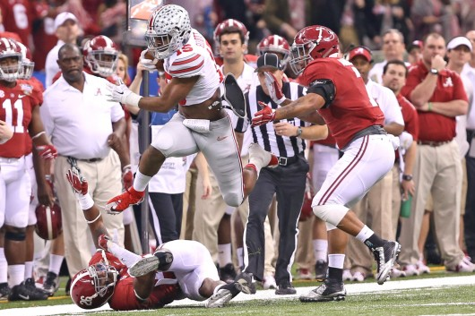 Sophomore running back Ezekiel Elliott (15) carries the ball during the 2015 Allstate Sugar Bowl against Alabama on Jan. 1 in New Orleans. OSU won, 42-35.  Credit: Mark Batke / Photo editor